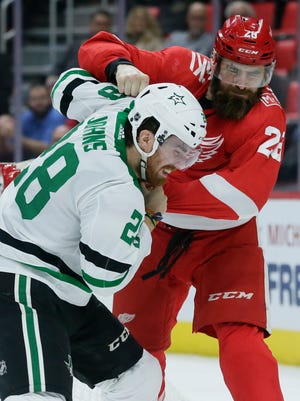 Stars defenseman Stephen Johns, left, fights with Red Wings right wing Luke Witkowski during the second period of the Wings' 4-2 loss on Tuesday, Jan. 16, 2018, at Little Caesars Arena.