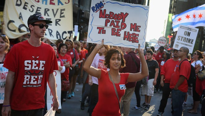 Thousands of Chicago public school teachers and their supporters march through the Loop and in front of the Chicago Public Schools (CPS) headquarters in September 2012 in Chicago, Ill.
