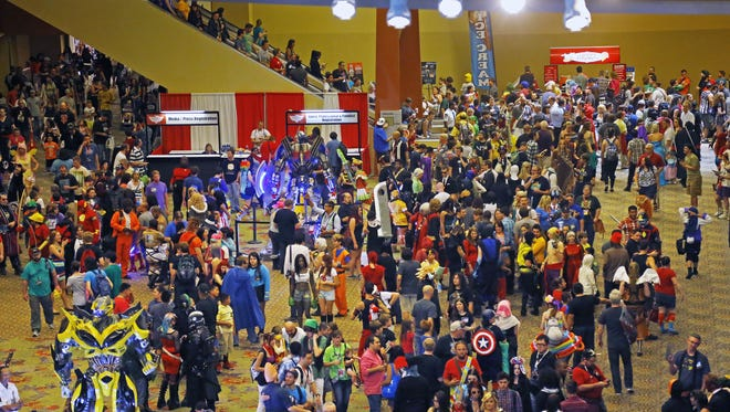 Crowds pack the Phoenix Convention Center during Phoenix Comicon Saturday,  June, 7, 2014 in Phoenix.