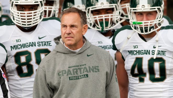 Michigan State head coach Mark Dantonio prepares to lead the team on the field before the game against Illinois at an NCAA college football game, Saturday, Oct. 26, 2013 at Memorial Stadium in Champaign, Ill.