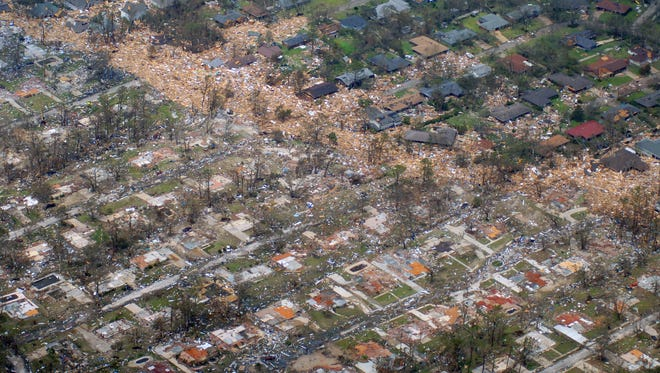 Homes wiped from their foundations by wind and tidal surge form a debris line through a residential area in Long Beach the day after Hurricane Katrina tore across teh Mississippi Gulf Coast.