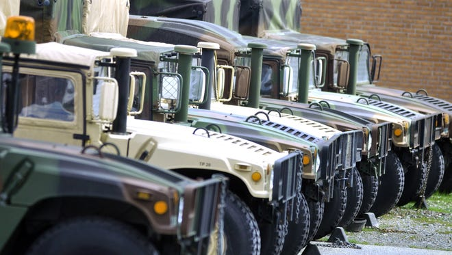 Military Humvee's are lined up outside the Maryland National Guard Blair L. Crockett Armory in Salisbury. (Matthew S. Gunby Photo)