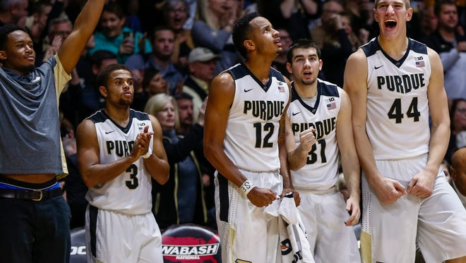 WEST LAFAYETTE, IN - DECEMBER 5: Members of the Purdue Boilermakers celebrate during the game against the New Mexico Lobos at Mackey Arena on December 5, 2015 in West Lafayette, Indiana. Purdue defeated New Mexico 70-58. (Photo by Michael Hickey/Getty Images)