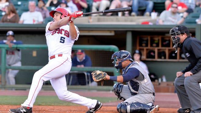 Bats infielder Seth Mejias-Brean gets a hit in their home opener against Toledo at Louisville Slugger Field, Thursday, Apr. 14, 2016 in Louisville Ky.