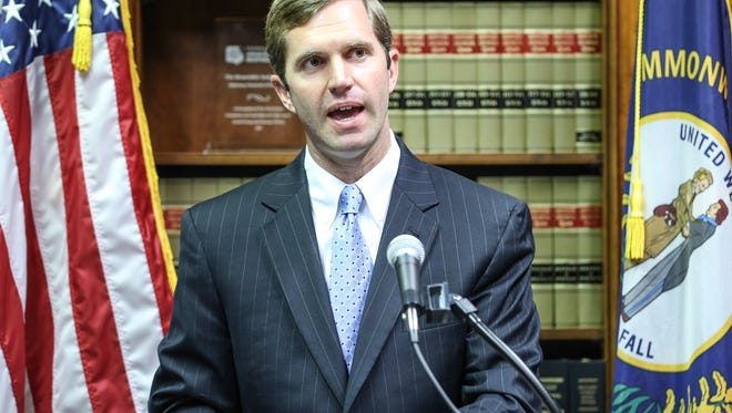 Kentucky Attorney General Andy Beshear spoke to the media during a press conference talking about the AG's office suing the Bevin administration for disbanding two boards in recent weeks.