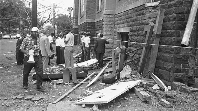 "FILE - In a Sept. 15, 1963 file photo, investigators work outside the 16th Street Baptist Church in Birmingham, Ala., following an explosion that killed four young girls. The city of Birmingham is planning five days of events with political leaders, artists and ordinary citizens to mark the 50th anniversary of the racist church bombing that killed four black girls. Attorney General Eric Holder, former Secretary of State Condoleezza Rice, director Spike Lee and actor Jamie Foxx are among those participating in what's being called ""Empowerment Week."" Events begin Wednesday, Sept, 11 and continue through Sunday, Sept. 15, the anniversary of the bombing of the church. Three Ku Klux Klansmen were convicted in the bombing years later. (AP Photo/File)"