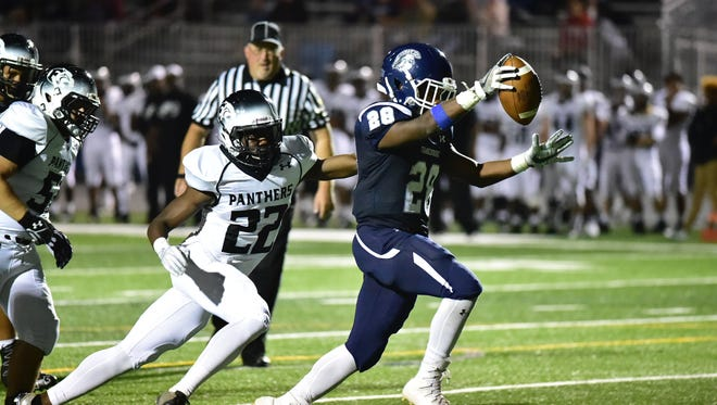Chambersburg's Keyshawn Jones (28) scores a touchdown for the Trojans in the first half against CD East.