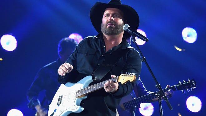 Garth Brooks performs at the 51st annual CMA Awards at the Bridgestone Arena on Nov. 8, 2017 in Nashville.