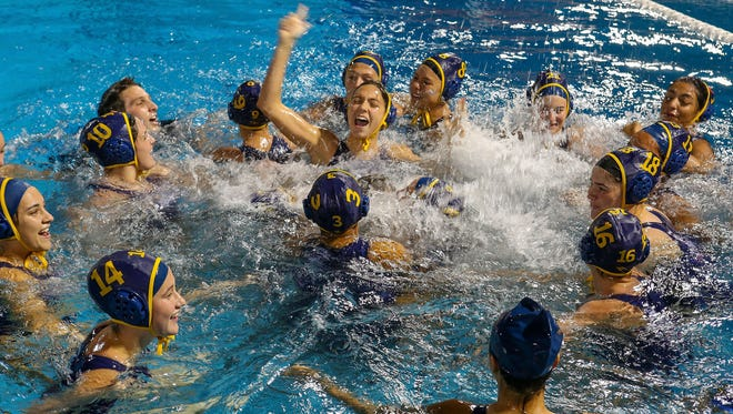 The La Quinta girls celebrate their win over Xavier Prep in DVL championship water polo, February 7, 2018.