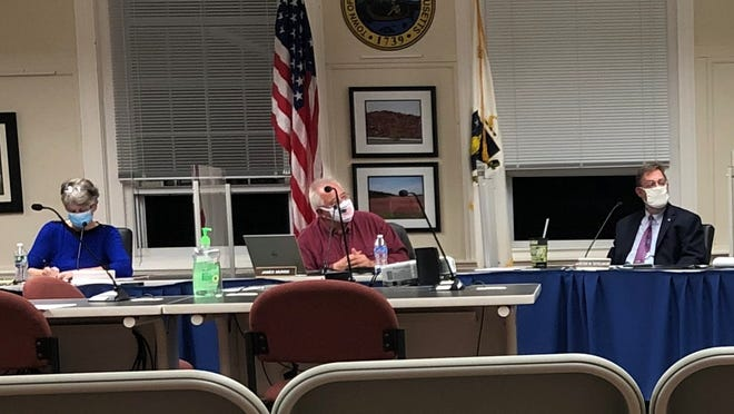Amid a recent COVID-19 spike, Town Administrator Derek Sullivan, far right, repeated a request from last week that town board members conduct their meetings while masked - but he added some teeth to it this week.