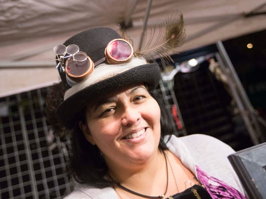 Serena Agha, of Dark Goddess Creations, sports a steam punk top hat during First Fridays down Roosevelt Row, Friday, January 2, 2015 in Phoenix, Ariz.