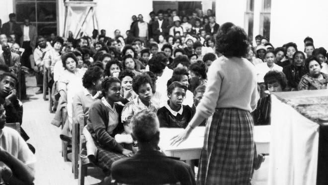 In this 1964 photo provided by Larry Rubin, people participate in Freedom Summer activities.