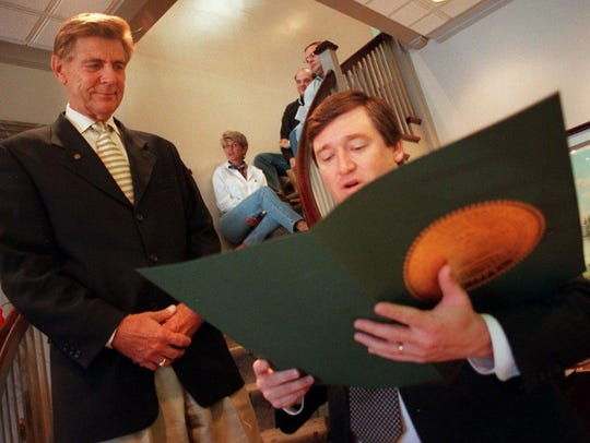 State representative Mike Williams, right, reads a proclamation to Gordon Inman, chairman of Franklin Financial Corp. Williams is the last Democrat to win an election for office in Williamson County.
