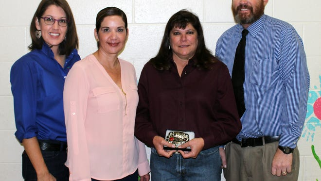 Julie Janecka, second from right, has been named New Mexico Ag in the Classroom 2018 Teacher of the Year. Also pictured, from left, are NMAITC Southern Director Traci Curry, East Picacho Elementary Principal Nubia Tarazona, and East Picacho Elementary Vice Principal James Dickerson.