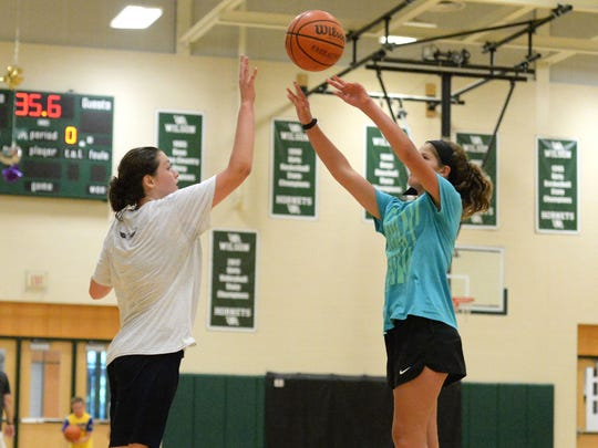 Cecilia Robinson, 11, shoots over a defender Monday at the Wilson Memorial basketball camp.
