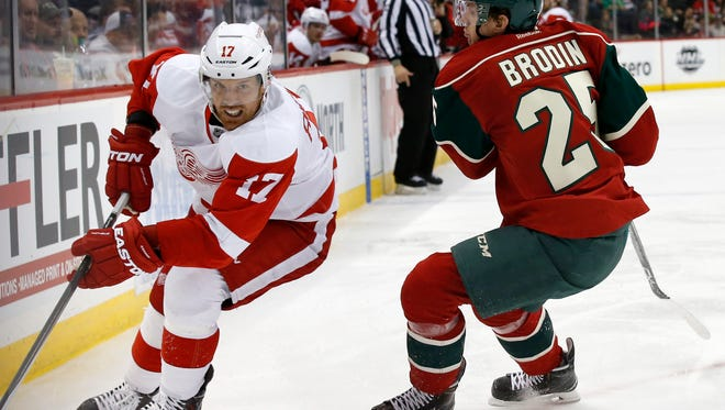 Red Wings center Brad Richards (17) controls the puck past Wild defenseman Jonas Brodin (25) during the second period of an NHL hockey game in St. Paul, Minn., Monday.