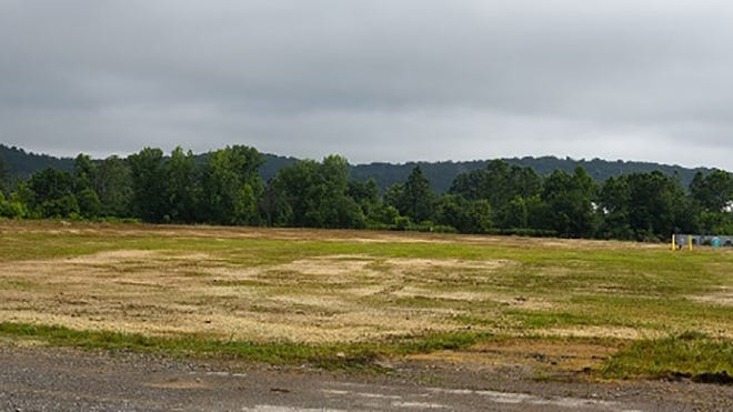 A view of the former K-832 Basin area after workers removed the basin and backfilled and seeded the site.
