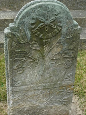 The intricate carving on Jacob Berger's headstone is representative of the German culture brought to the Shenandoah Valley.