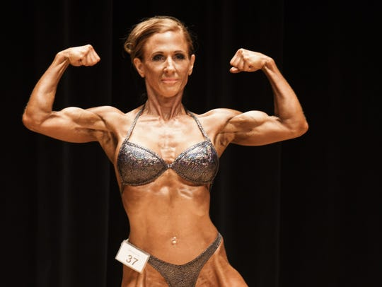 Beth Mandyck in a bodybuilding pose. The different