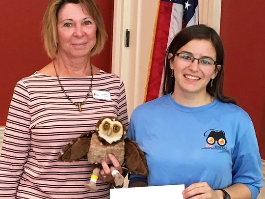 Daughters of the American Revolution (DAR) member, Lou Baush, presented a check to Allison Smith, a graduate student at the University of Florida, toward her burrowing owl project on Marco Island. She is working understand the habitat needs of the unique owls to ensue their long-term survival as empty lots become scarcer on Marco Island.