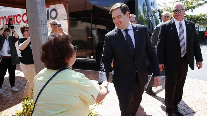 Sen. Marco Rubio, GOP presidential candidate, greets a woman at Temple Beth El in Palm Beach. Rubio plans a 2 p.m.  campaign stop today in Brevard, at That Little Restaurant, 1749 N. Wickham Road, Melbourne.
