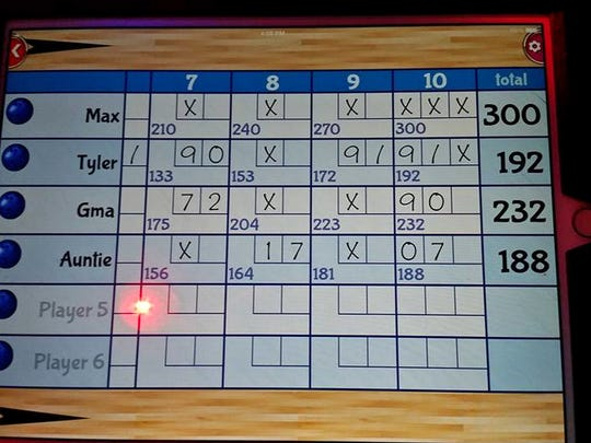 A screen shows the duckpin bowling scores earned by