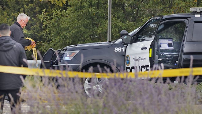 """Kingston police at the scene where an officer shot a man outside the Kingston Collection mall. A 25-year-old man, who police say """"threatened"""" officers, was shot by a Kingston police officer shortly before 3 a.m. on Tuesday, Sept. 22, 2020."""