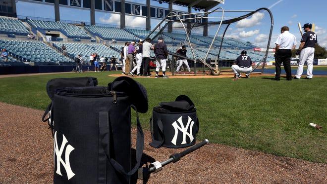 New York Yankees catchers take batting practice during a spring training baseball workout Monday, Feb. 22, 2016, in Tampa, Fla.