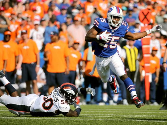 Bills running back LeSean McCoy slips the tackle by Broncos Zaire Anderson.  McCoy only ran for 21 yards but caught seven passes for 48 yards to help beat Denver 26-16.