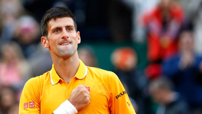 Novak Djokovic celebrates after beating Tomas Berdych in their final match at the Monte-Carlo Rolex Masters.
