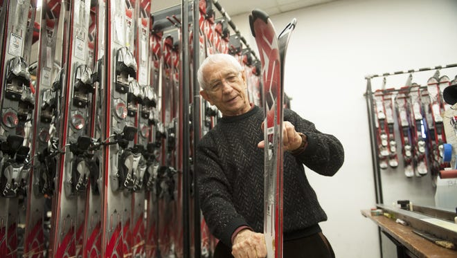 Bob Danzeisen, co-owner of Danzeisen & Quigley, displays a pair of rental skis at Danzeisen & Quigley in Cherry Hill.  02.03.15