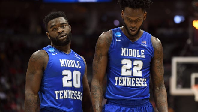 Middle Tennessee State's  Giddy Potts (20) and  JaCorey Williams (22) walk off the court after being defeated by the Butler Bulldogs in the second round of the 2017 NCAA Tournament in Milwaukee on March 18, 2017.
