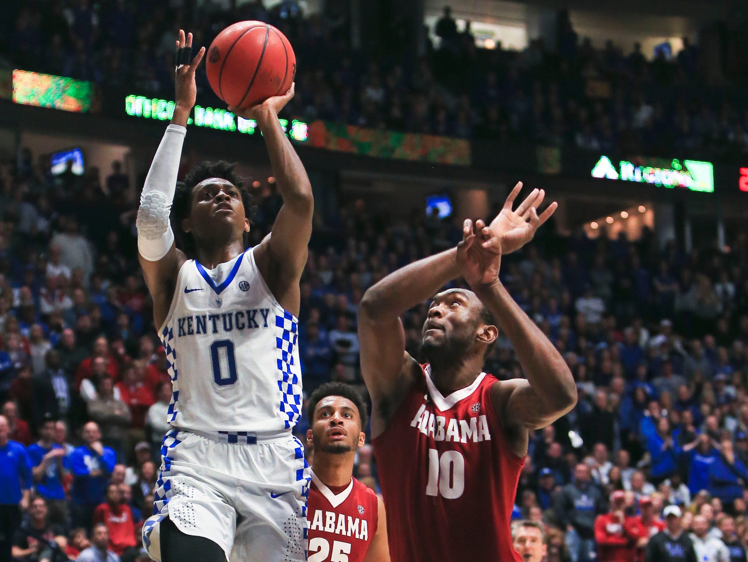 Kentucky's De'Aaron Fox goes for two of his career-high 28 points with this layup to easily seal the Wildcats' victory over the Tide Saturday afternoon in the SEC semifinal tournament game in Nashville.