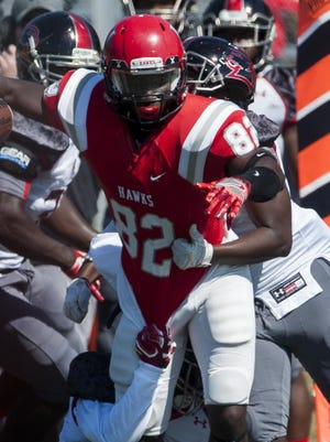 Huntingdon's Otis Porter (82) is stopped by LaGrange at the Huntingdon campus on Saturday, October 15, 2019.