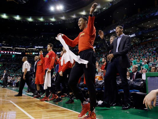 Atlanta Hawks forward Kent Bazemore waves a towel from the bench during the third quarter against the Boston Celtics in Game 6 of a first-round NBA basketball playoff series Thursday, April 28, 2016, in Boston. The Hawks won 104-92 and took the series 4-2. (AP Photo/Elise Amendola)
