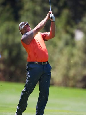 Former NHL player Jeremy Roenick hits the ball from the fairway during the American Century Championship on Saturday at Edgewood Tahoe Golf Course in Stateline, Nev.