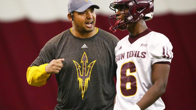 Arizona State Sun Devils coach Tony White talks to defensive back Timarcus Davis (6) during spring football practice on Feb. 6 in Tempe.