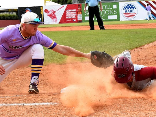 Luke Oehrle looks to make a back pick at First Base