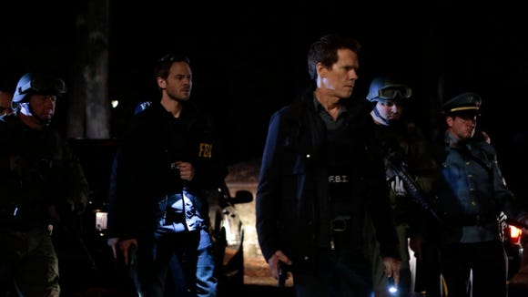 """THE FOLLOWING: Agent Weston (Shawn Ashmore, L) and Ryan Hardy (Kevin Bacon, R) continue their hunt for Lily Gray but are forced to redirect their search when a new threat presents itself in the """"Sacrifice"""" episode of THE FOLLOWING airing Monday, March 3 (9:00-10:00 PM ET/PT) on FOX. ©2014 Fox Broadcasting Co. CR: Giovanni Rufino/FOX"""