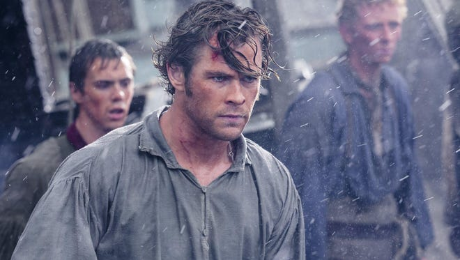 "Chris Hemsworth, center, in ""In the Heart of the Sea"" with Sam Kelley, left, and Edward Ashley."