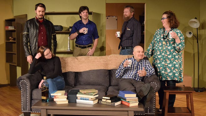 "Faculty members and a student gather at an impromptu retirement party for Professor John Oldman (Ian Dalziel in the blue shirt) in a scene from ""The Man from Earth."" A debate ensues when the guests learn that Oldman is immortal. The play opens Jan. 20 at Riverfront Playhouse. Standing: Forrest Spade, left, Ian Dalziel, Ben Van Sickle and Tammy Jones. Seated: Carly Sinclair, left, Chris Gomez."