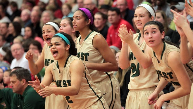 West High's starters cheer on their teammates from the bench in the final moments of their game at City High on Friday, Jan. 9, 2015. David Scrivner / Iowa City Press-Citizen