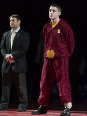 Evansville Mater Dei wrestler Nick Lee is introduced as one of the finalist in the 132-pound weight class. The 77th Annual IHSAA State Wrestling Finals at Bankers Life Fieldhouse in Indianapolis, Saturday, Feb. 21, 2015.