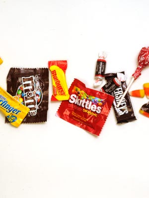 Most kids and half of adults eat candy on Halloween, research from the NPD Group shows.