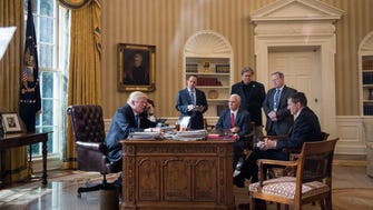 President Trump speaks on the phone with Russian President Vladimir Putin in the Oval Office of the White House on Jan. 28, 2017, along with Vice President Pence and Chief of Staff Reince Priebus, Chief Strategist Steve Bannon, Press Secretary Sean Spicer and National Security Advisor Michael Flynn.    In the first seven months of his administration, Trump has seen the departures of many senior aides including Priebus, Bannon, Spicer and Flynn.