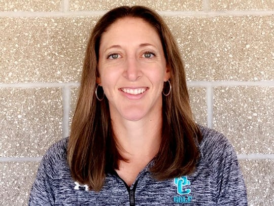 Gulf Coast High School boys golf coach Kimberly Benedict