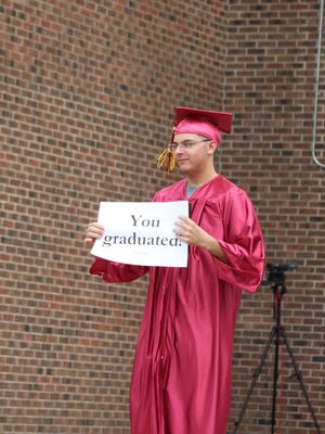 Case High grad Shawn Koohy stops to have his photo taken.