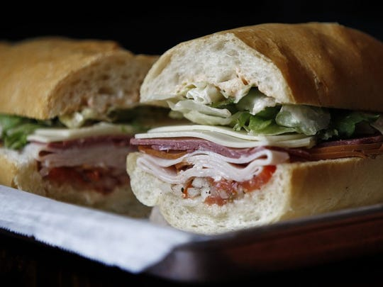 The New York Club at Fino's features corned beef, turkey and Swiss cheese on a baguette from La Baguette bakery.