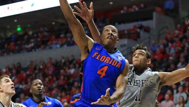 Florida guard KeVaughn Allen shoots last Saturday night against Ole Miss forward Sebastian Saiz. The Rebels entered the game hoping to stop him from going on an extended run, but defensive lapses allowed him to score 27 points.