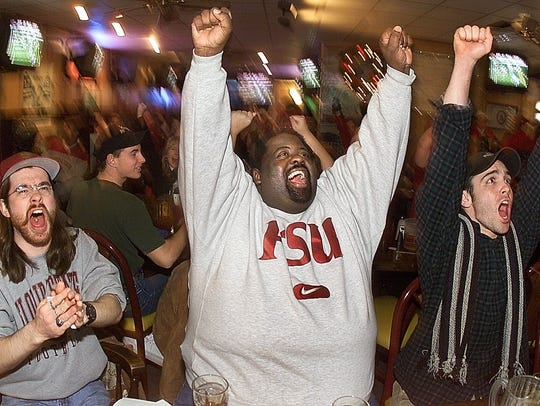 Football fans at the 4th Quarter Bar and Grille get